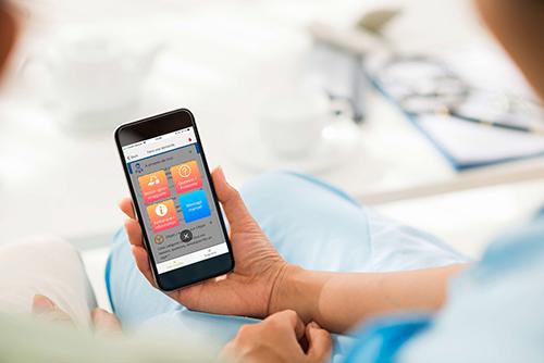 L'application Hospitalink sur le smartphone d'un patient